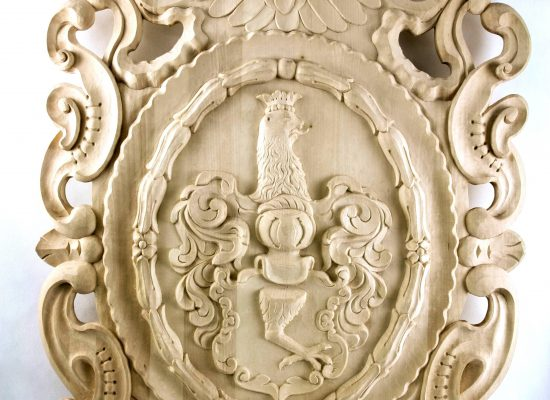 Hand-carved family emblems