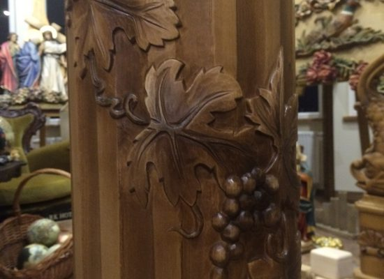 Non-rotating wooden columns with ornamentation. Hand carved.