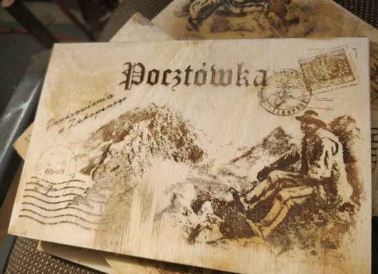 Wood laser engraving - stylization of an old postcard