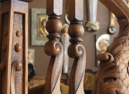 Hand-carved wood railing elements. Unturned.